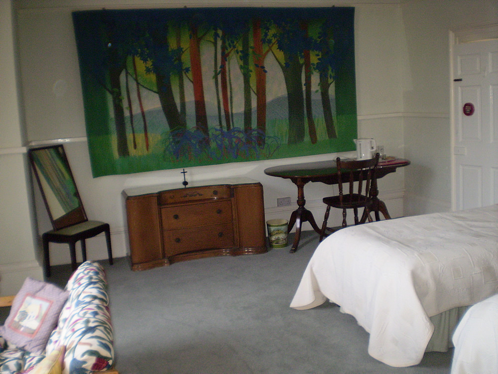 bedroom with wall hangings
